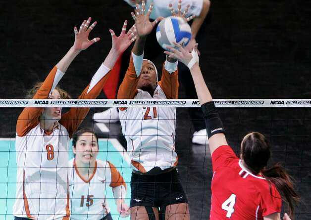 Texas' Destinee Hooker (21) and Jennifer Doris (8) block a kill attempt by Nebraska's Lindsey Licht (4), in the NCAA college volleyball Omaha regional final match in Omaha, Neb., Saturday, Dec. 12, 2009. Texas beat Nebraska 21-25, 25-18, 25-16, 25-17. Photo: Nati Harnik, Associated Press / AP