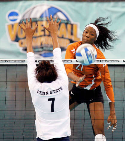 Texas' Destinee Hooker, right, hits past Penn State's Arielle Wilson during the NCAA college volleyball national championship match Saturday, Dec. 19, 2009, in Tampa, Fla. Photo: Mike Carlson, Associated Press / FR155492 AP