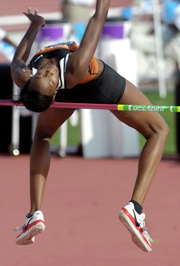 Texas' Destinee Hooker makes at attempt during the high jump finals at the NCAA Outdoor Track and Field Championships in Fayetteville, Ark., on Friday, June 12, 2009. Photo: Beth Hall, Associated Press / FR129439 AP
