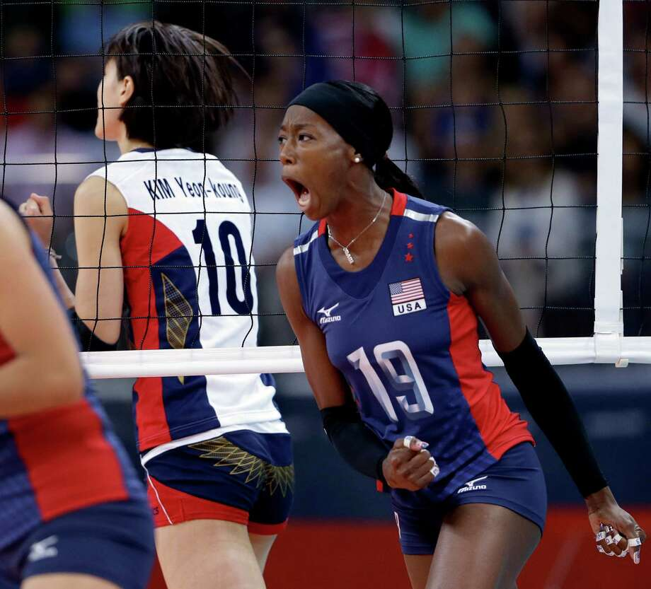 United States' Destinee Hooker, right, celebrates after getting a shot past South Korea's Kim Yeon-Koung, left, during a women's preliminary volleyball match at the 2012 Summer Olympics, Saturday, July 28, 2012, in London. Photo: Jeff Roberson, Associated Press / AP