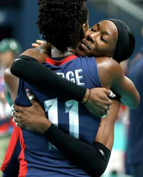 USA's Destinee Hooker (19, right) hugs teammate Megan Hodge (11) after the team lost to Brazil 3-1during a women's volleyball gold medal match at the 2012 Summer Olympics Saturday, Aug. 11, 2012, in London. Photo: Chris O'Meara, Associated Press / AP