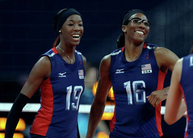United States' Destinee Hooker, left, and Foluke Akinradewo celebrate during a women's preliminary volleyball match against Serbia at the 2012 Summer Olympics, Friday, Aug. 3, 2012, in London. Photo: Jeff Roberson, Associated Press / AP