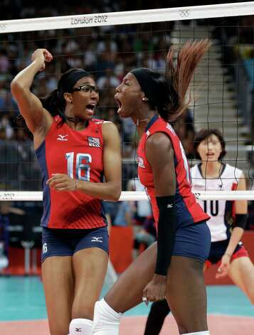 USA's Destinee Hooker (19, right) and teammate Foluke Akinradewo (16) react to a point against South Korea during a women's volleyball semifinal match at the 2012 Summer Olympics Thursday, Aug. 9, 2012, in London. Photo: Chris O'Meara, Associated Press / AP