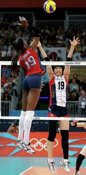USA's Destinee Hooker (19) goes high over South Korea's Kim Hee-jin (19) for a point during a women's volleyball semifinal match at the 2012 Summer Olympics Thursday, Aug. 9, 2012, in London. Photo: Chris O'Meara, Associated Press / AP