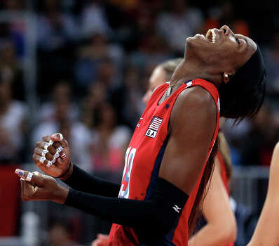 United States' Destinee Hooker laughs during a women's preliminary volleyball match against Turkey at the 2012 Summer Olympics, Sunday, Aug. 5, 2012, in London. The United States won in three sets. Photo: Jeff Roberson, Associated Press / AP