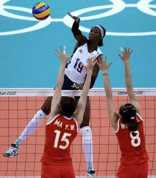 United States' Destinee Hooker (19) spikes over China's Ma Yunwen (15) and Wei Qiuyue during a women's preliminary volleyball match at the 2012 Summer Olympics, Wednesday, Aug. 1, 2012, in London. Photo: Jeff Roberson, Associated Press / AP
