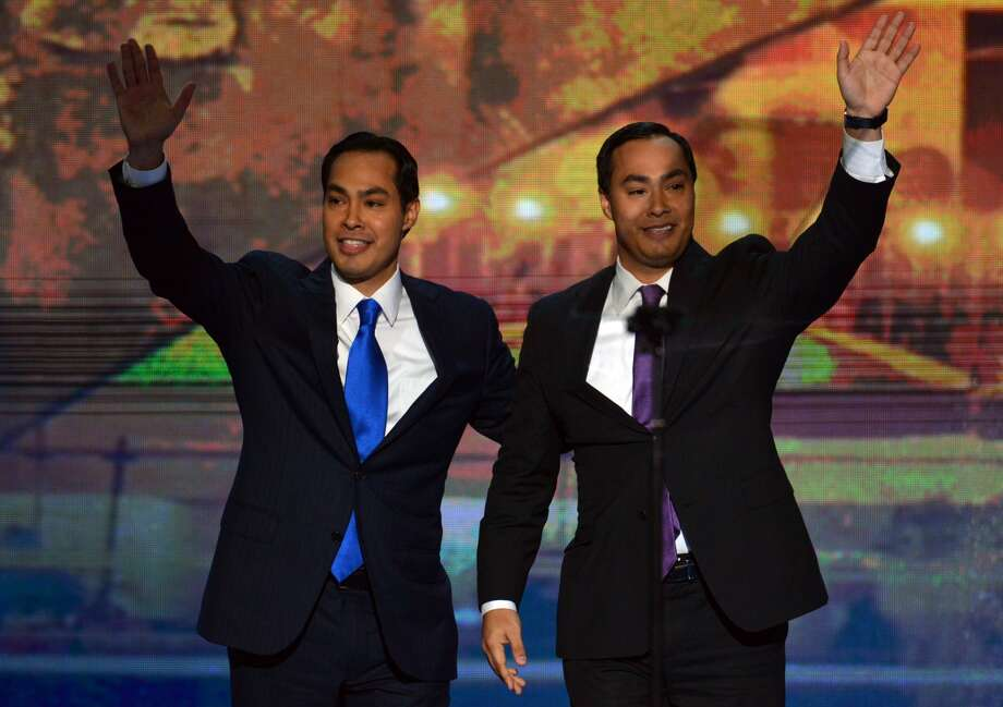 San Antonio Mayor Julian Castro (L) and his brother Joaquin Castro wave to the audience  at the Time Warner Cable Arena in Charlotte, North Carolina, on September 4, 2012 on the first day of the Democratic National Convention (DNC). The DNC is expected to nominate US President Barack Obama to run for a second term as president. Photo: GettyImages