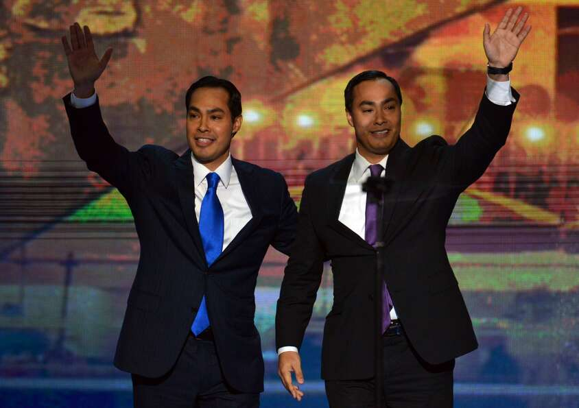 San Antonio Mayor Julian Castro (L) and his brother Joaquin Castro wave to the audience  at the