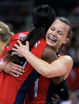 United States' Destinee Hooker, left, gets a hug from teammate Courtney Thompson during a women's preliminary volleyball match against Turkey at the 2012 Summer Olympics, Sunday, Aug. 5, 2012, in London. The United States won in three sets. Photo: Jeff Roberson, Associated Press / AP