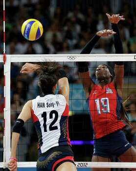 USA's Destinee Hooker (19) blocks a smash by South Korea's Han Song-yi (12) during a women's volleyball semifinal match at the 2012 Summer Olympics Thursday, Aug. 9, 2012, in London. Photo: Chris O'Meara, Associated Press / AP