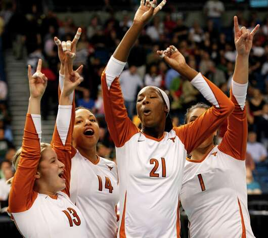 Texas players, from left to right, Cristina Arenas, Sha'Dare McNeal, Destinee Hooker and Juliann Faucette celebrate their win over Minnesota in the NCAA college volleyball national semifinal match Thursday, Dec. 17, 2009, in Tampa, Fla. Texas won 3-0 to advance to the national championship game on Saturday, Dec. 19. Photo: Mike Carlson, Associated Press / FR155492 AP