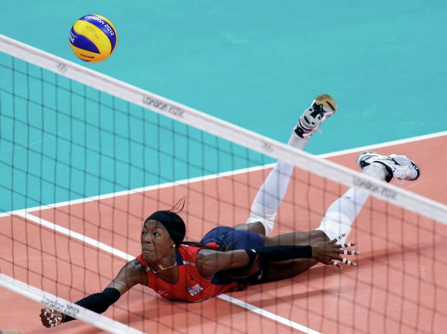 United States' Destinee Hooker saves the ball during a women's preliminary volleyball match against Turkey at the 2012 Summer Olympics, Sunday, Aug. 5, 2012, in London. Photo: Jeff Roberson, Associated Press / AP