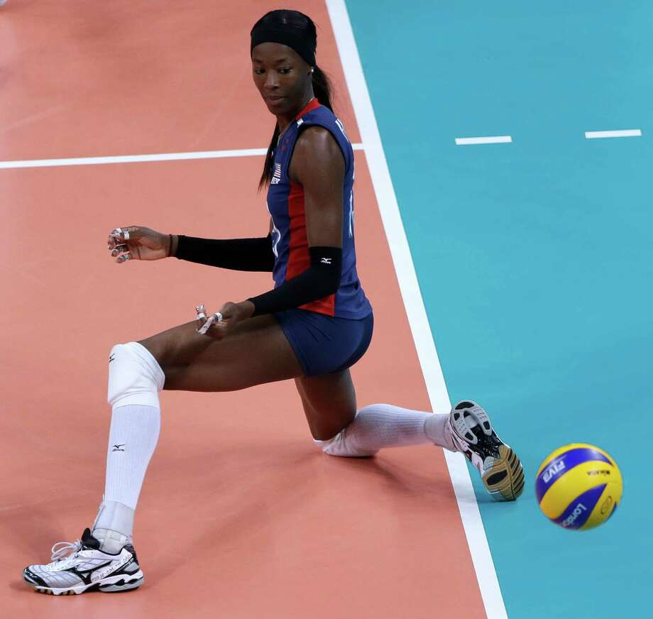 United States' Destinee Hooker watches after a ball bounces in for a Brazil point during a women's gold medal volleyball match at the 2012 Summer Olympics, Saturday, Aug. 11, 2012, in London. Photo: Jeff Roberson, Associated Press / AP