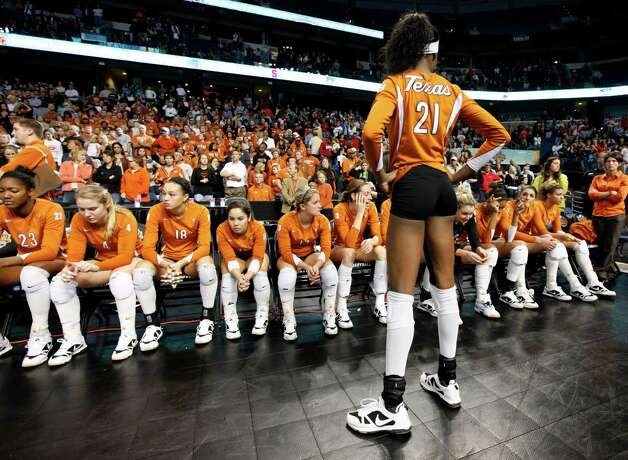 Texas' Destinee Hooker (21) and her teammates react after losing to Penn State in the NCAA college volleyball national championship match Saturday, Dec. 19, 2009, in Tampa, Fla. Penn State won 22-25, 20-25, 25-23, 25-21, 15-13. Photo: Mike Carlson, Associated Press / FR155492 AP