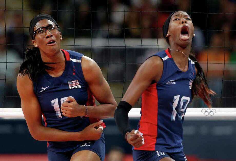 United States players Foluke Akinradewo, left, and Destinee Hooker react during the women's gold medal volleyball match against Brazil at the 2012 Summer Olympics, Saturday, Aug. 11, 2012, in London. Photo: Dave Martin, Associated Press / AP