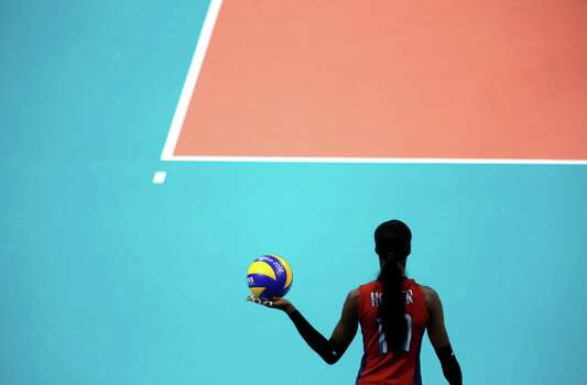 United States' Destinee Hooker prepares to serve during a women's semifinal volleyball match against South Korea at the 2012 Summer Olympics, Thursday, Aug. 9, 2012, in London. Photo: Jeff Roberson, Associated Press / AP