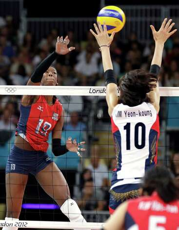 USA's Destinee Hooker (19) spikes the ball past South Korea's Kim Yeon-koung (10) for a point during a women's volleyball semifinal match at the 2012 Summer Olympics Thursday, Aug. 9, 2012, in London. Photo: Chris O'Meara, Associated Press / AP