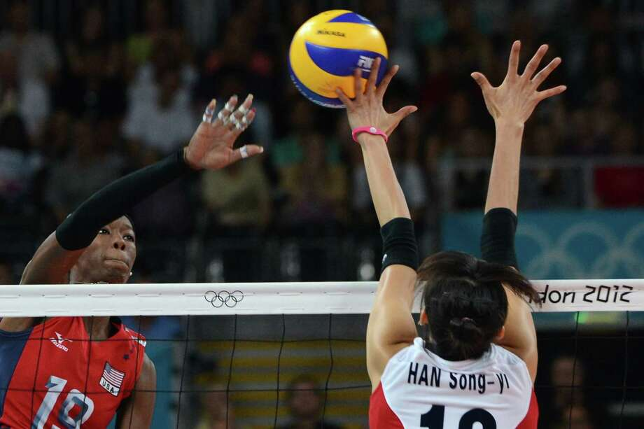 Destinee Hooker of the US (L) spikes as South Korea's Han Song-Yi (R) attempts to block during the Women's semifinal volleyball match between South Korea and the US in the 2012 London Olympic Games in London on August 9, 2012. Photo: KIRILL KUDRYAVTSEV, AFP / Getty Images / AFP