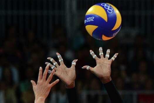US player Destinee Hooker attempts to block during the Women's semifinal volleyball match between South Korea and the US in the 2012 London Olympic Games in London on August 9, 2012. Photo: KIRILL KUDRYAVTSEV, AFP / Getty Images / AFP