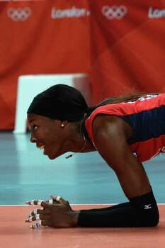 US player Destinee Hooker reacts during the Women's semifinal volleyball match between South Korea and the US in the 2012 London Olympic Games in London on August 9, 2012. Photo: KIRILL KUDRYAVTSEV, AFP / Getty Images / AFP