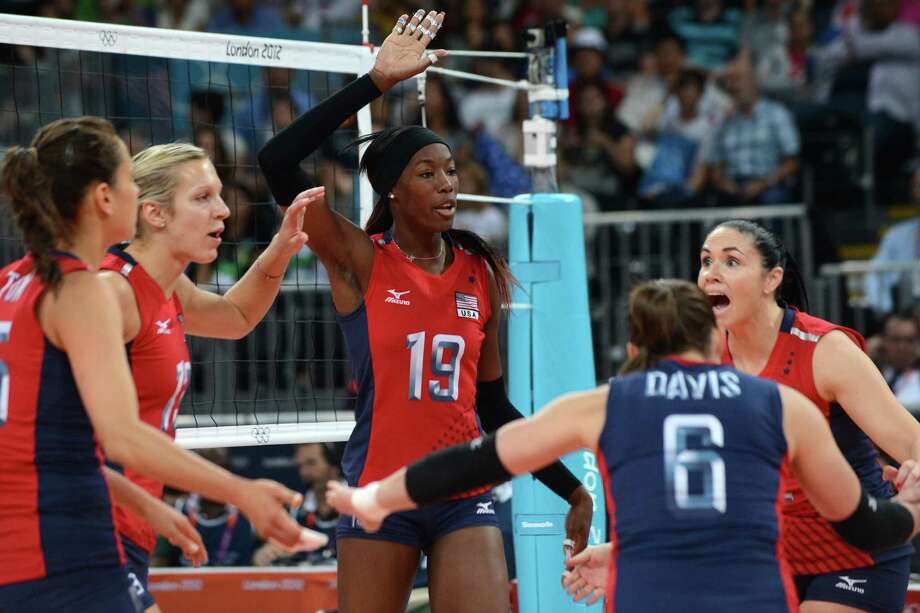 US player Destinee Hooker (C) reacts during the Women's semifinal volleyball match between South Korea and the US in the 2012 London Olympic Games in London on August 9, 2012. Photo: KIRILL KUDRYAVTSEV, AFP / Getty Images / AFP