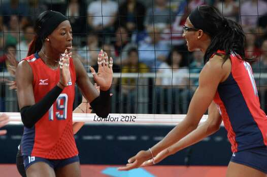 US' Destinee Hooker (L) and Foluke Akinradewo celebrate winning a point during the Women's preliminary pool B volleyball match between the US and Turkey in the 2012 London Olympic Games in London on August 5, 2012. Photo: KIRILL KUDRYAVTSEV, AFP / Getty Images / AFP