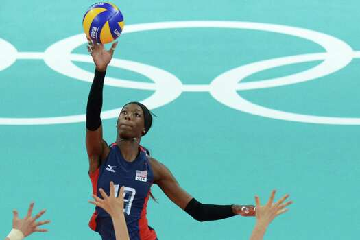 US' Destinee Hooker spikes during the women's volleyball match between the USA and South Korea during the 2012 London Olympic Games in London on July 28, 2012. Photo: KIRILL KUDRYAVTSEV, AFP / Getty Images / AFP