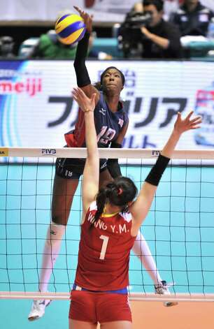 Destinee Hooker (top) of the US spikes the ball over Wang Yimei (bottom) of China during their World Cup women's volleyball tournament in Tokyo on November 16, 2011. The US beat China 3-2 (25-21, 31-29, 18-25, 19-25, 15-10). Photo: KAZUHIRO NOGI, AFP / Getty Images / AFP