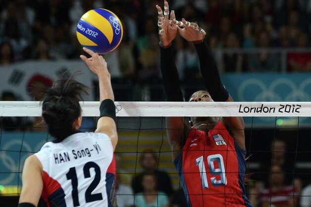 South Korea's Han Song-Yi (L) spikes as US player Destinee Hooker (R) attempts to block during the Women's semifinal volleyball match between South Korea and USA in the 2012 London Olympic Games in London on August 9, 2012. Photo: KIRILL KUDRYAVTSEV, AFP / Getty Images / AFP