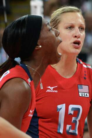 Destinee Hooker of the US (L) reacts during the Women's semifinal volleyball match between South Korea and the US in the 2012 London Olympic Games in London on August 9, 2012. Photo: KIRILL KUDRYAVTSEV, AFP / Getty Images / AFP