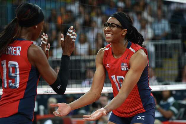 Foluke Akinradewo (R) and Destinee Hooker of the US react during the Women's semifinal volleyball match between South Korea and the US in the 2012 London Olympic Games in London on August 9, 2012. Photo: KIRILL KUDRYAVTSEV, AFP / Getty Images / AFP
