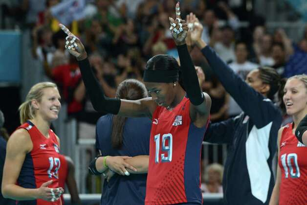 Destinee Hooker of the US (C) celebrates with teammates Christa Harmotto (L) and Jordan Larson (R) after victory in the Women's semifinal volleyball match between South Korea and the US in the 2012 London Olympic Games in London on August 9, 2012. Photo: KIRILL KUDRYAVTSEV, AFP / Getty Images / AFP