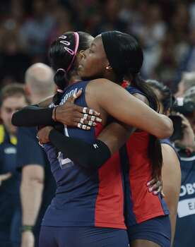 US Danielle Scott-Arruda (L) and Destinee Hooker comfort each other after losing to Brazil in the gold medal by defeating the US in the women's volleyball gold medal match of the London 2012 Olympics Games, in London on August 11, 2012. Photo: MANAN VATSYAYANA, AFP / Getty Images / AFP