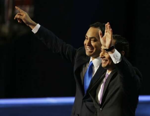 San Antonio Mayor Julian Castro, left, and his brother Joaquin Castro, wave at delegates at the Democratic National Convention in Charlotte, N.C., on Tuesday, Sept. 4, 2012. (AP Photo/Lynne Sladky) (Lynne Sladky / Associated Press)