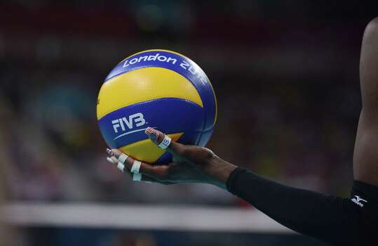 US Destinee Hooker serves during the women's volleyball gold medal match of the London 2012 Olympics Games against Brazil, in London on August 11, 2012. Photo: MANAN VATSYAYANA, AFP / Getty Images / AFP