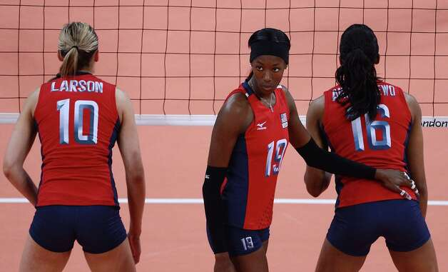 Destinee Hooker of US (C) watches as a teammate serves during their Women's semi-final volleyball match against South Korea in the London 2012 Olympic Games at the Earl's Court Arena in London on August 9, 2012. USA beat South Korea 25-20, 25-22, 25-22. Photo: MANAN VATSYAYANA, AFP / Getty Images / AFP