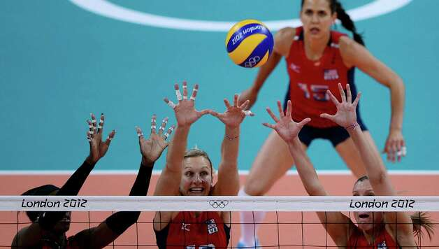 Christa Harmotto (C), Destinee Hooker (L) and Jordan Larson of the US block a shot during their Women's semi-final volleyball match in the London 2012 Olympic Games at the Earl's Court Arena in London on August 9, 2012. USA beat South Korea 25-20, 25-22, 25-22. Photo: MANAN VATSYAYANA, AFP / Getty Images / AFP