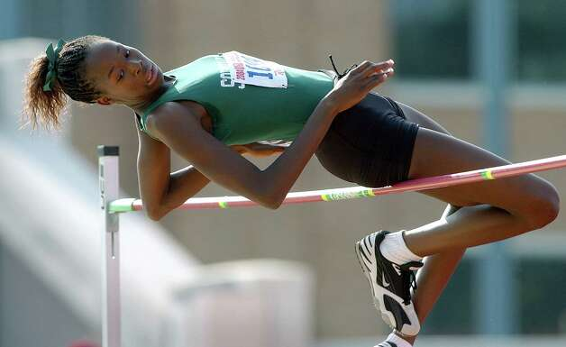 Destinee Hooker hangs in with the leaders in the high jump as the bar went to 6 feet at the state track meet on May 15, 2004. Photo: TOM REEL, San Antonio Express-News / SAN ANTONIO EXPRESS-NEWS