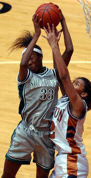 Southwest's Destinee Hooker (33) and Madison's Diondra Arenas (52) fight for a rebound Friday, Feb. 20, 2004 at the UTSA Convocation Center. Photo: EDWARD A. ORNELAS, San Antonio Express-News / SAN ANTONIO EXPRESS-NEWS