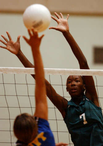 Southwest's Destinee Hooker (7) looks to block a shot by Tivy's Autumn Vara (4) during their match Tuesday, September 9, 2003 at Southwest High School Gymnasium. Photo: BAHRAM MARK SOBHANI, San Antonio Express-News / SAN ANTONIO EXPRESS-NEWS
