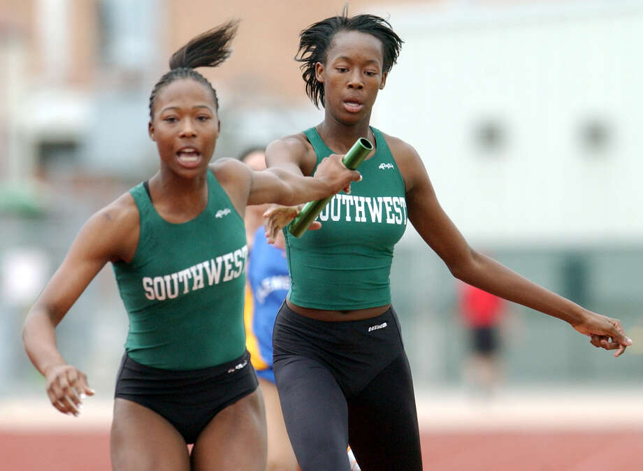 Marshevet Hooker gets the handoff from her sister Destinee Hooker during the 1600-meter relay Saturday, March 8, 2003 at the Judson stadium. Photo: EDWARD A. ORNELAS, San Antonio Express-News / SAN ANTONIO EXPRESS-NEWS