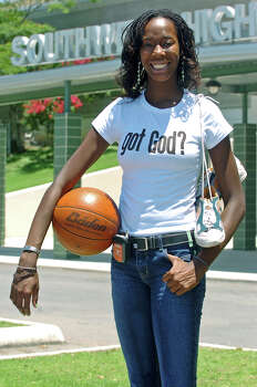 Southwest basketball player Destinee Hooker poses in front of the school on June 16, 2005. Photo: TOM REEL, San Antonio Express-News / SAN ANTONIO EXPRESS-NEWS