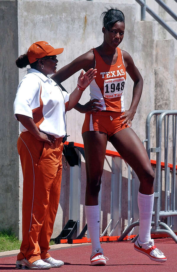 Texas' Destinee Hooker gets some advicce during the high jump competition at the Texas Relays from University of Texas assistant coach Rose Brimmer. Hooker won the event. April 7, 2006. Photo: TOM REEL, San Antonio Express-News / SAN ANTONIO EXPRESS-NEWS