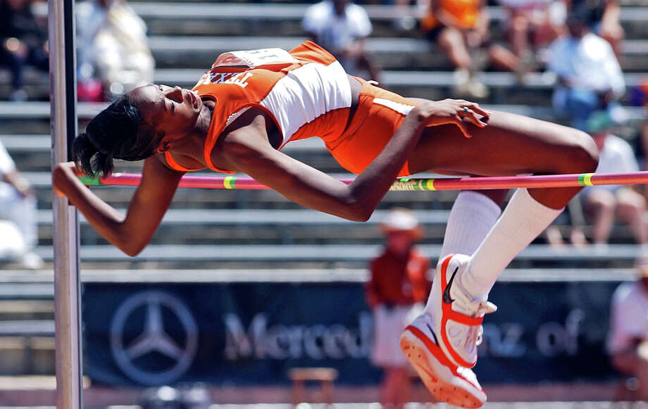 "Destinee Hooker clears her final height , 6' 1"", to win the university level high jump competiton at the Texas Relays in Austin on April 7, 2006. Photo: TOM REEL, San Antonio Express-News / SAN ANTONIO EXPRESS-NEWS"