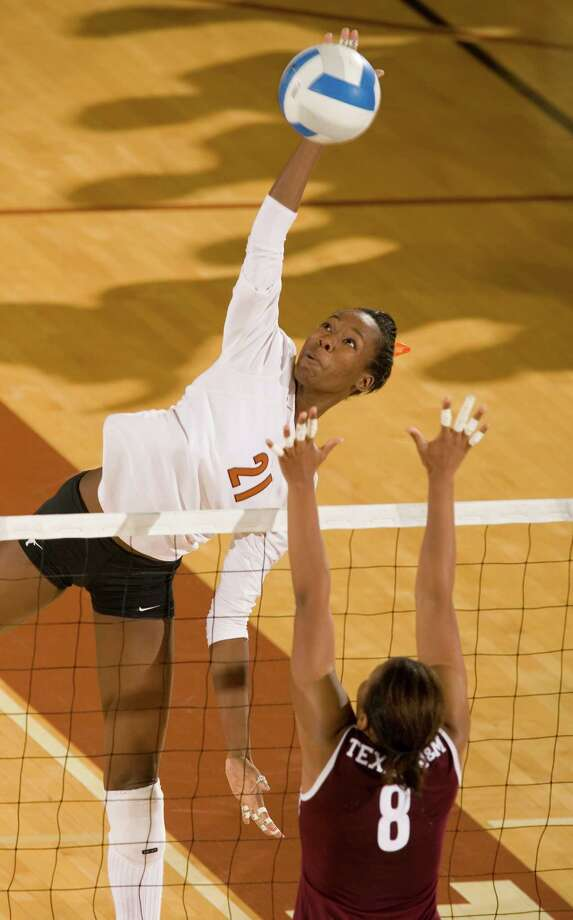 Texas' #21 Destinee Hooker spikes the ball over Texas A&M's # 8 Courtnee Rhodes during the Texas vs Texas A&M game held on November 8, 2006 at Gregory Gym in Austin, Texas. Texas defeated A&M in three games, 30-22, 30-16 and 30-18. Photo: JIM SIGMON, The University Of Texas / Jim Sigmon / UT Sports Photography Dept.
