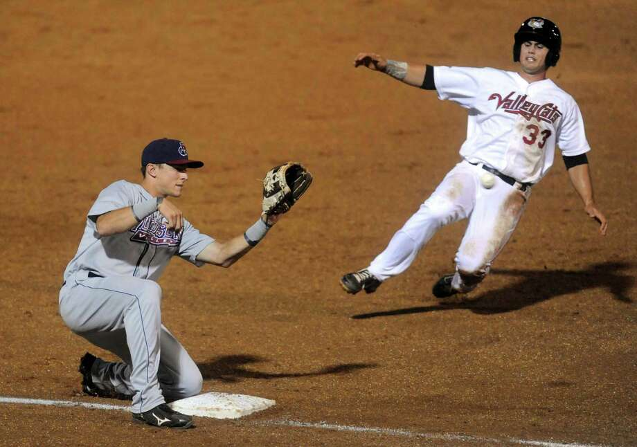 ValleyCats outfielder Preston Tucker, slides into third base to be tagged out by Richie Shaffer during their game against the Hudson Valley Renegades at Joe Bruno Stadium in Troy, NY Tuesday Sept. 4, 2012. (Michael P. Farrell/Times Union) Photo: Michael P. Farrell