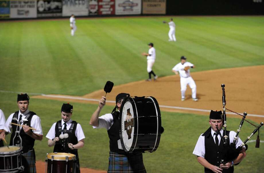 The Columbia District Pipe Band playes between innings on Irish Night during the ValleyCats game against the Hudson Valley Renegades at Joe Bruno Stadium in Troy, NY Tuesday Sept. 4, 2012. (Michael P. Farrell/Times Union) Photo: Michael P. Farrell