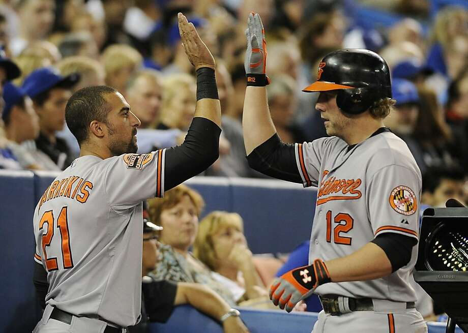 Reynolds (No. 12) went 3-for-4 with four RBIs. Photo: Brad White, Getty Images