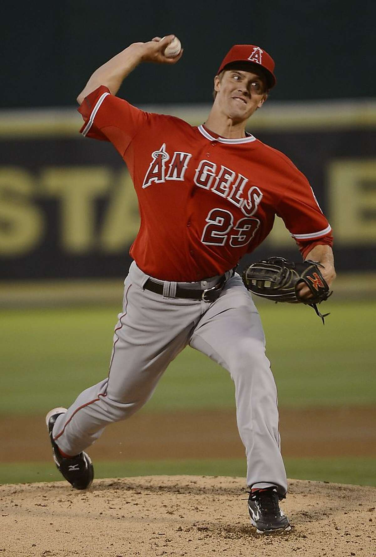 OAKLAND, CA - SEPTEMBER 04: Zack Greinke #23 of the Los Angeles Angels of Anaheim pitches against the Oakland Athletics at O.co Coliseum on September 4, 2012 in Oakland, California. (Photo by Thearon W. Henderson/Getty Images)