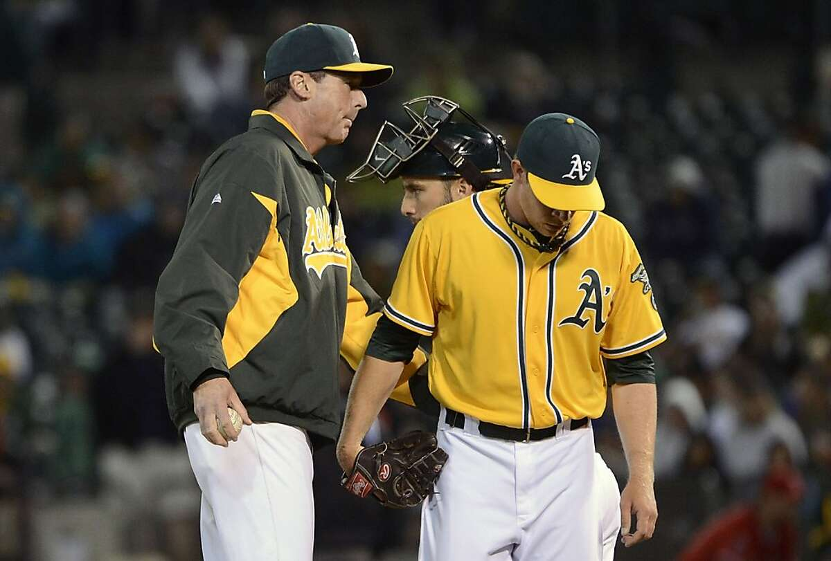 OAKLAND, CA - SEPTEMBER 04: Manager Bob Melvin #6 of the Oakland Athletics takes the ball from Sean Doolittle #62, taking him out of the game in the eighth inning against the Los Angeles Angels of Anaheim at O.co Coliseum on September 4, 2012 in Oakland, California. (Photo by Thearon W. Henderson/Getty Images)